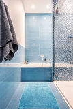 Bathtub in blue bathroom Royalty Free Stock Images