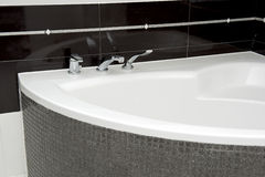 Bathtub details. A view of a modern bathroom with bathtub Royalty Free Stock Photography