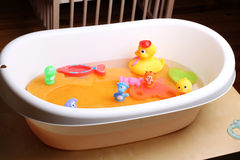 Bathtub with ducks and other toys for babies Royalty Free Stock Photography