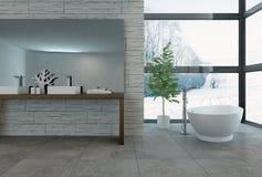 Bathtub facing large windows in bathroom Stock Images
