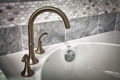 Bathtub faucet. New bathtub bathroom faucet with tile walls Stock Image
