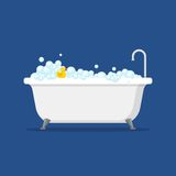 Bathtub with foam bubbles inside and bath yellow rubber duck isolated on blue background. Bath time in flat style Stock Photo