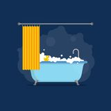 Bathtub with foam bubbles inside and bath yellow rubber duck and open shower curtain isolated on blue background. Bath Royalty Free Stock Images
