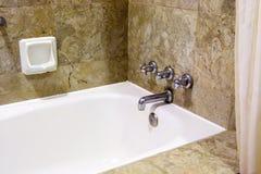 Bathtub in hotel bathroom Stock Photography