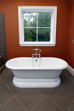 Bathtub and red walls Royalty Free Stock Photography