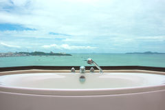 Bathtub in restroom on sea view Stock Photos