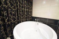 Bathtub. Round bathtub in hotel room Stock Photography