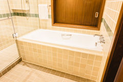 Bathtub and shower box. Decoration in bathroom interior - Vintage Light Filter Royalty Free Stock Photography