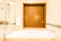 Bathtub and shower box. Decoration in bathroom interior - Vintage Light Filter Royalty Free Stock Images