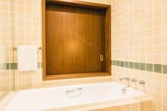 Bathtub and shower box. Decoration in bathroom interior - Vintage Light Filter Stock Images