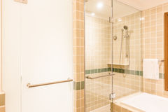 Bathtub and shower box. Decoration in bathroom interior - Vintage Light Filter Stock Photography