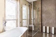 Bathtub and shower. With glass door in stylish spacious bathroom Royalty Free Stock Images