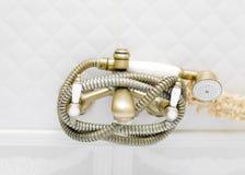 Bathtub Shower Hose. Bathtub shower spray hose, closeup front shot Royalty Free Stock Photo