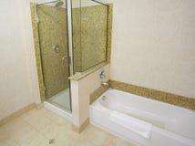 Bathtub and shower. In a small hotel bathroom Stock Photos