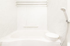 Bathtub and shower. White bathtub and shower at clean bathroom Stock Images