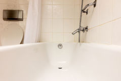 Bathtub in a tiled bathroom. Old white bathtub in a tiled bathroom stock photos