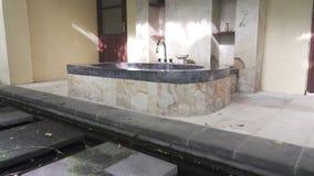 Bathtub in a tropical garden under the open sky.  stock footage