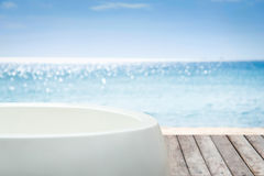 Bathtub with view to the sea. Bathtub with view to the sea background stock image