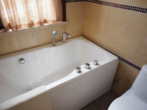 Bathtub. White bathtub in hotel bathroom Royalty Free Stock Photo