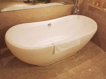 Bathtub. White bathtub in hotel bathroom Royalty Free Stock Photography