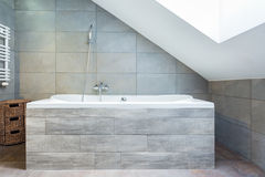 Bathtub with wooden housing Royalty Free Stock Photos