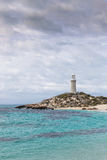 Bathurst Lighthouse on Rottnest Island. Cloudy skies over Pinky Beach and Bathurst Lighthouse at Rottnest Island, near Perth in Western Australia stock photo