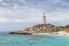 Bathurst Lighthouse on Rottnest Island. Cloudy skies over Pinky Beach and Bathurst Lighthouse at Rottnest Island, near Perth in Western Australia royalty free stock images