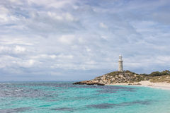 Bathurst Lighthouse on Rottnest Island. Cloudy skies over Pinky Beach and Bathurst Lighthouse at Rottnest Island, near Perth in Western Australia royalty free stock photo