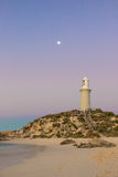 Bathurst Lighthouse on Rottnest Island. At twilight time with a conspicuous moon. The island is situated near Perth and Fremantle in Western Australia stock photography