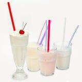 Batido de leche con una paja en un glass5 Fotografía de archivo libre de regalías