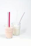 Batido de leche con una paja en un glass2 Fotografía de archivo