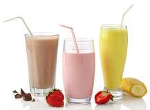 Batidos de leche de la fresa, del chocolate y del plátano Imagen de archivo libre de regalías