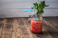 Batidos e aipo frescos do tomate em um frasco Foto de Stock Royalty Free