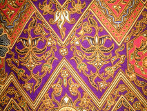 Batik fabric art texture. Indonesian batik cloth characteristic that have been entrenched Royalty Free Stock Photo