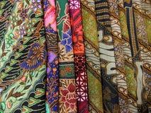 Batik fabris in a pile Royalty Free Stock Images