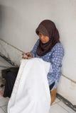 Batik making. Marking the patterns on traditional batik fabric Royalty Free Stock Photos