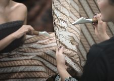 Two Women Painting Batik Java Indonesia. Batik painting tradition in Java. Batik Indonesia pattern, symbol and clohting has become a world heritage by UNESCO in royalty free stock photography