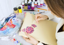 Batik process: artist paints on fabric, Batik painting Stock Photo