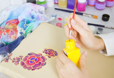 Batik process: artist paints on fabric, Batik painting Stock Image