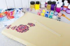 Batik process: artist paints on fabric, Batik painting Stock Images