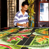 """Batik. Is a """"resist"""" process for making designs on fabric. The artist uses wax to prevent dye from penetrating the cloth, leaving """"blank"""" areas in the Royalty Free Stock Image"""