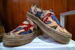 Batik Shoes. Unique item from Jakarta, Indonesia. Batik is a technique of wax-resist dyeing applied to whole cloth royalty free stock image