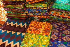 Batik. Traditional batik fabrics in stacks Stock Images