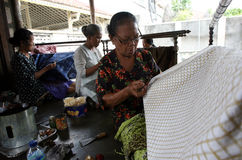 Batik. The women working on batik cloth in Solo, Central Java, Indonesia, batik is Indonesian traditional cloth Royalty Free Stock Photography