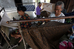 Batik. The women working on batik cloth in Solo, Central Java, Indonesia, batik is Indonesian traditional cloth Stock Photo