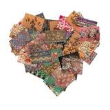 Batikcollage i hjärtaform Arkivbild