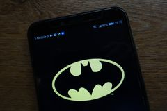 Batman logo displayed on a modern smartphone. KONSKIE, POLAND - SEPTEMBER 07, 2018: Batman logo displayed on a modern smartphone royalty free stock photography