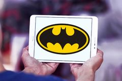 Batman logo. Logo of Batman on samsung tablet. Batman is a fictional superhero appearing in American comic books published by DC Comics stock images