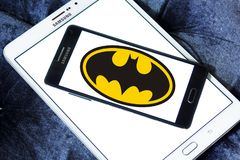 Batman logo. Logo of Batman on samsung tablet. Batman is a fictional superhero appearing in American comic books published by DC Comics stock photos