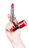 Batom e verniz para as unhas em uma mão Imagem de Stock Royalty Free
